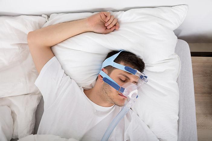 man sleeping arm over head.jpg