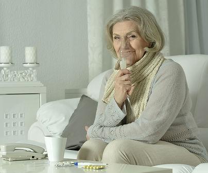 elderly woman with nebulizer.jpg