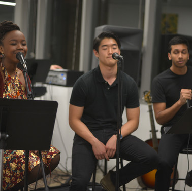 Students performing at an art exhibit