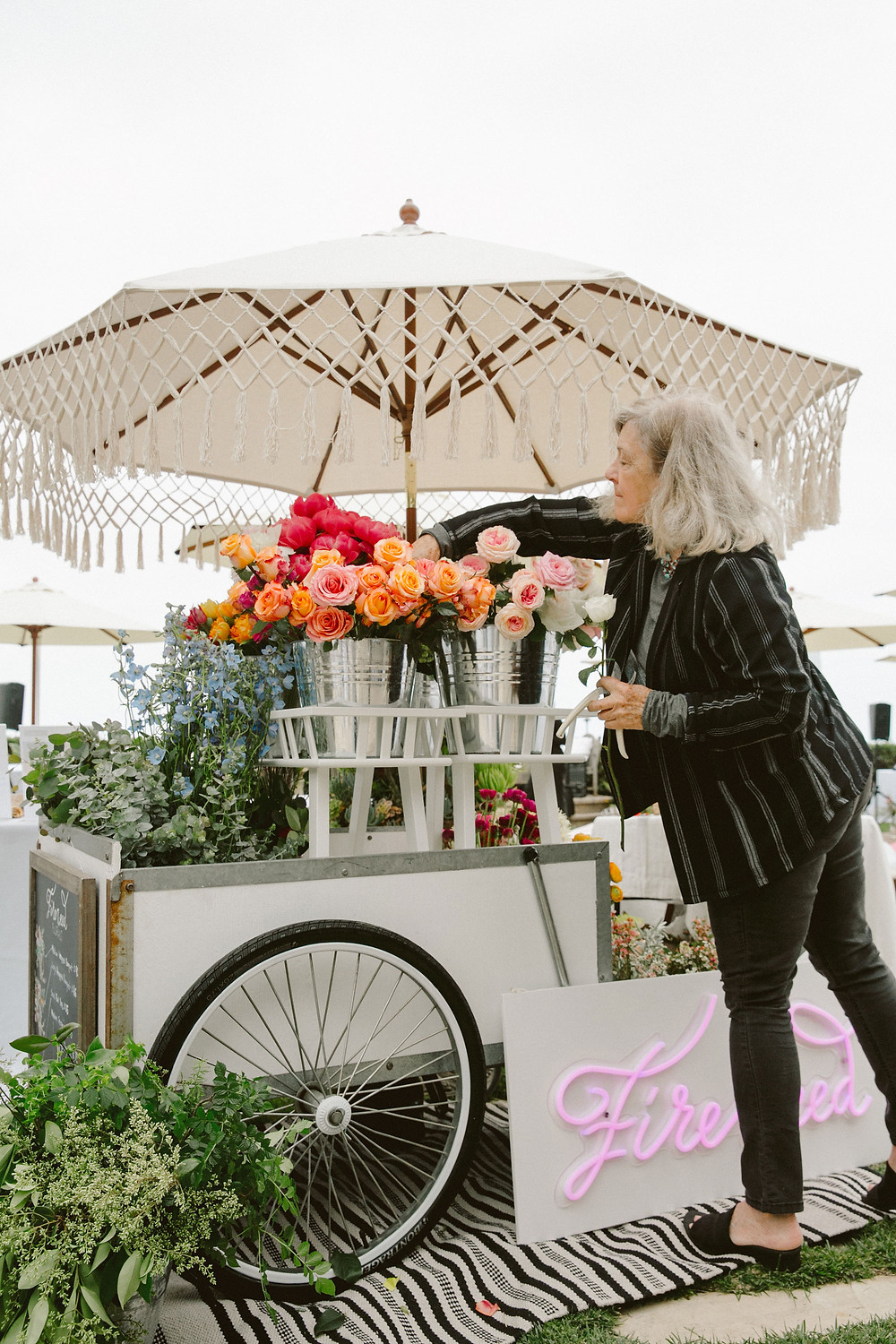 Fireweed Flower Cart with flowers and a neon pink sign