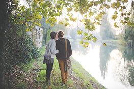 Couple walking by a lake