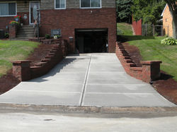 Retaining wall and driveway after