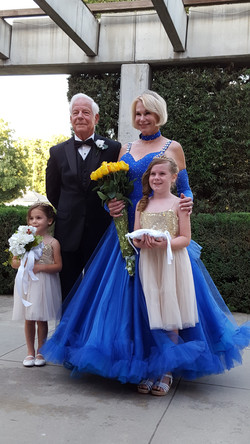 Queen Wendy, her husband Paul, and their grand daughters Olivia and Taylor