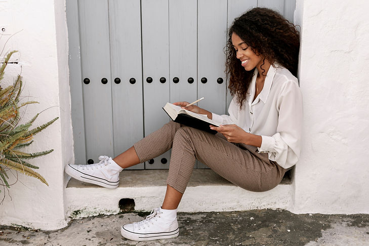 side-view-curly-woman-reading-book.jpg
