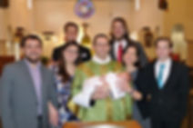 Father Joel Hampton and family after the Baptism of his grandson.