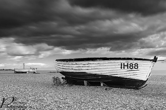 Aldeburgh beach, fishing boat with stormy clouds