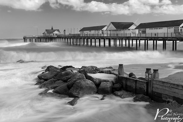 Southwold pier, Suffolk. Black & white composite image in high winds