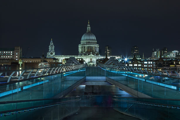 St Paul's cathedral at night with the Millennium bridge, lit at night, captured by Paul Norris Photography