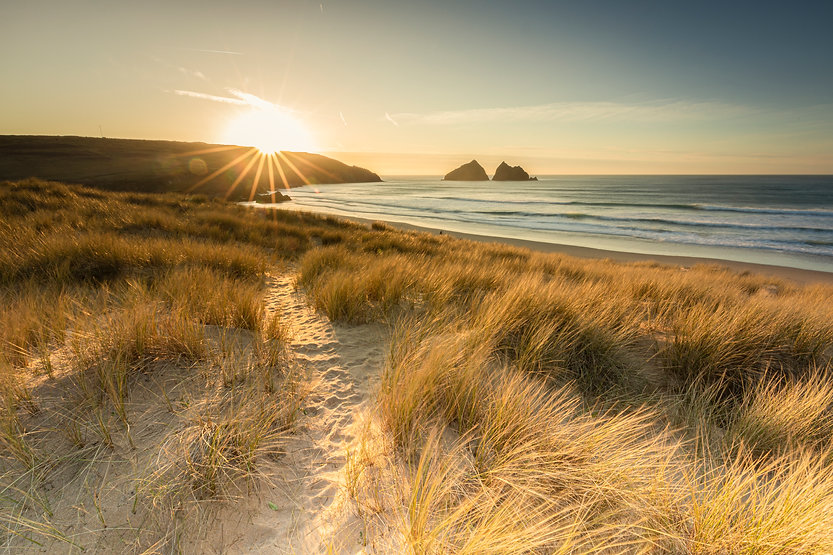 Beach sunset across the sand dunes by Paul Norris Photo