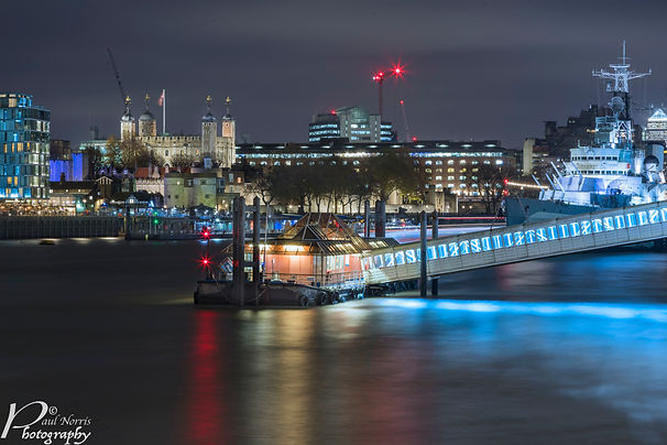 London bridge city pier with HMS Belfast & the Tower of of London, captured at night