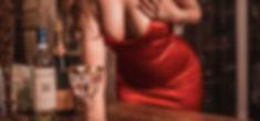 red dresss kitchen passing wine.jpg