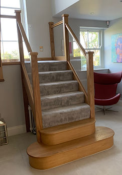 Oak and glass staircase with double bull nose
