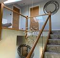 Glass balustrade with oak handrails