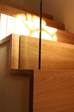 Oak cut string staircase with glass