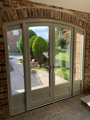Arched top timber doors