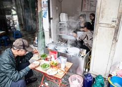 Eating Vietnamese Pho Bo In Hanoi, North Vietnam