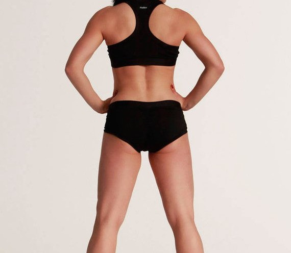 woman wearing black booty shorts with black sports bra