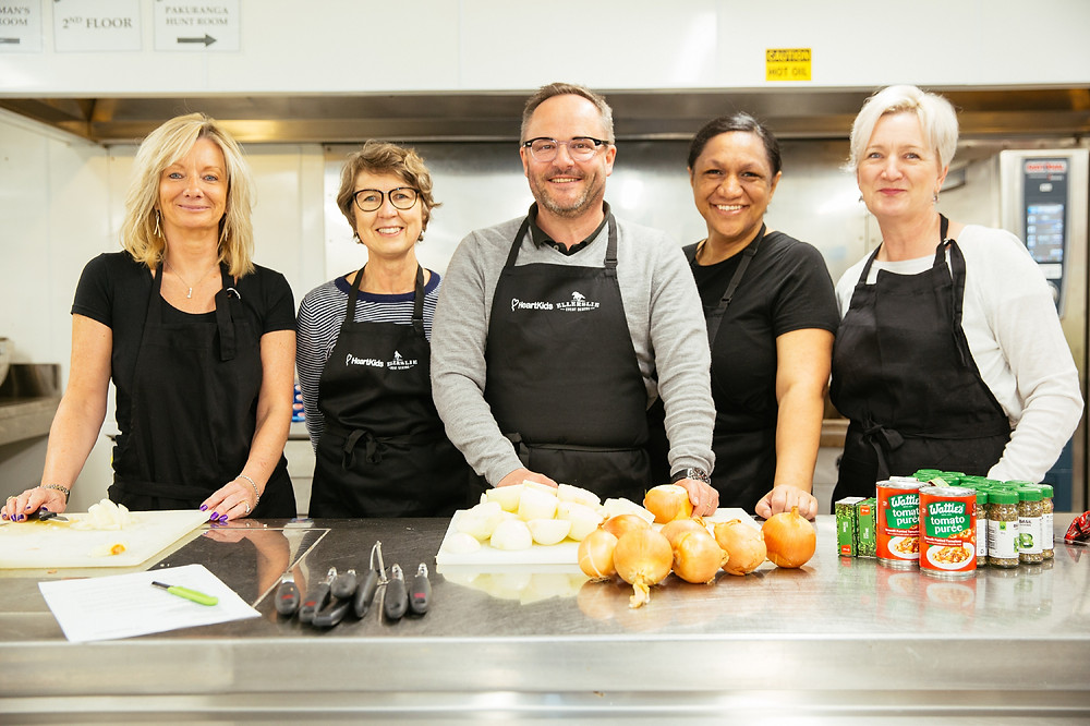 Our CEO Paul Wilcox is joined in our kitchen with volunteers for Heart Kids' Meals With Heart