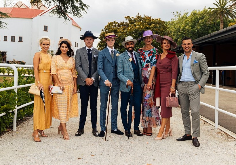 Hawaiian Airlines Fashions in the Field menswear placegetters (3rd, 4th & 5th from left) with the judges | Image copyright Auckland Racing Club