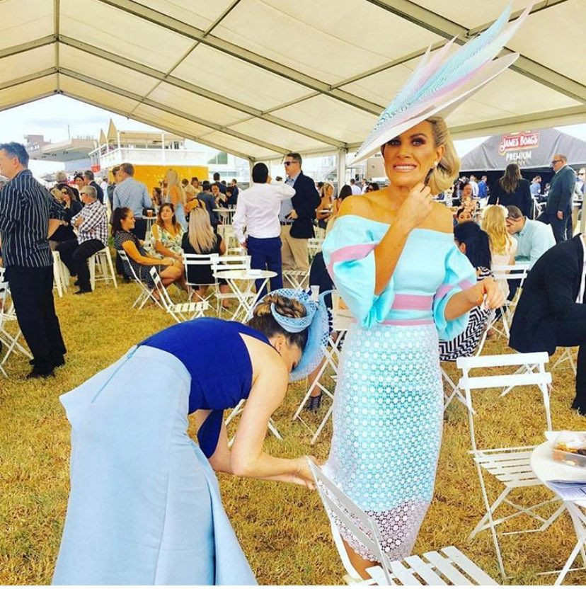 Katie getting 'fixed' by a fellow entrant at the Adelaide Cup