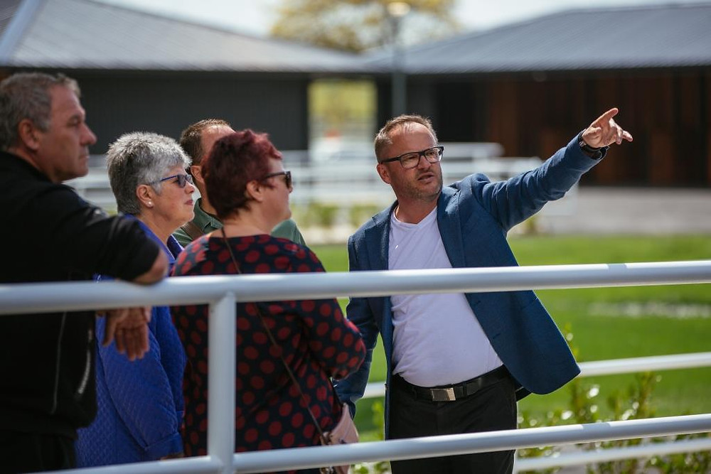 Paul Wilcox showing off the new stables complex to some club members