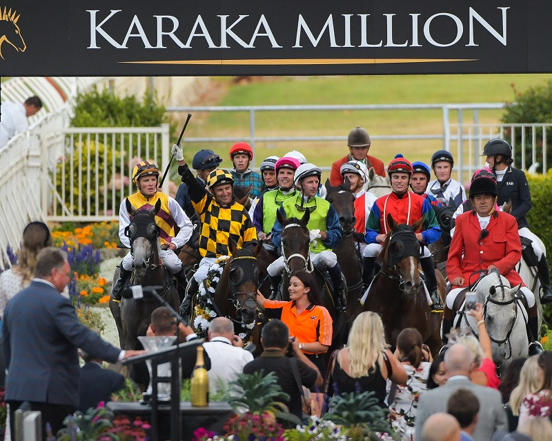 A victorious Opie Bosson salutes the judge after his win in the 2020 Karaka Million 3YO Classic aboard the Jamie Richards-trained Probabeel