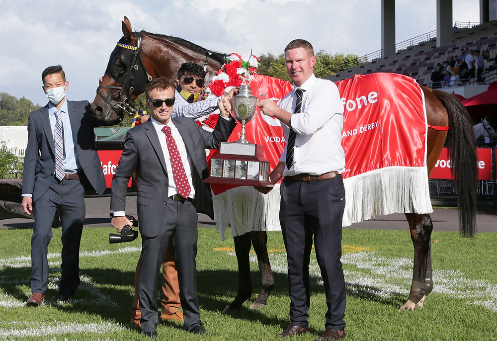 Trainers Lance O'Sullivan (left) and Andrew Scott pose with the Group I Vodafone New Zealand Derby trophy | Photo: Trish Dunell