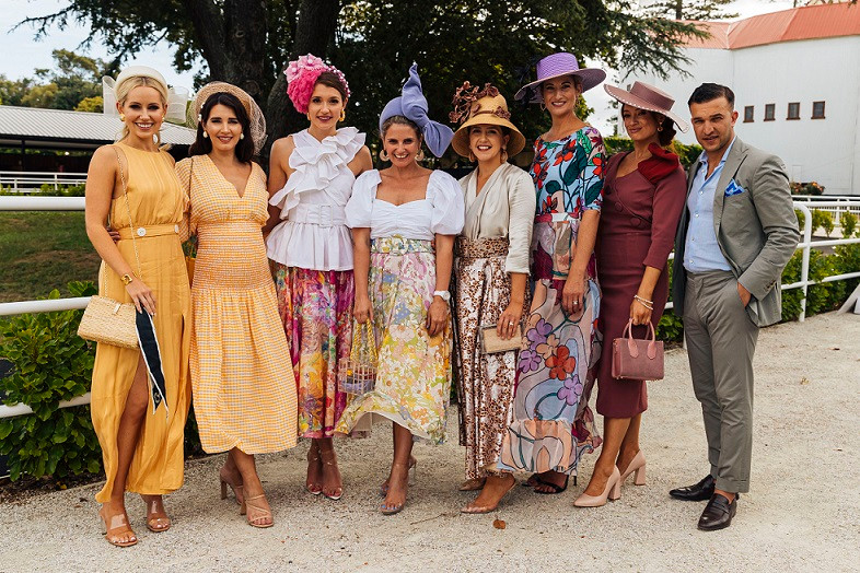 Aleisha alongside her fellow Hawaiian Airlines Fashions in the Field judges at Ellerslie on Boxing Day, plus the day's top three womenswear entrants (centre)