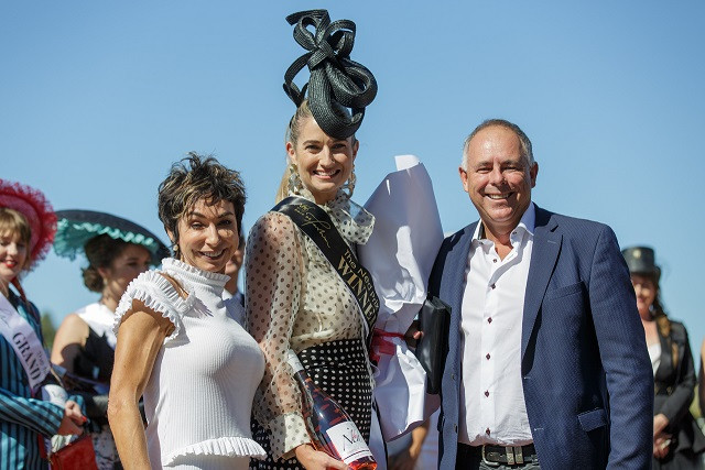 Aleisha on the winners' dais immediately after being announced the winner of The Ned Prix de Fashion 2019. Standing alongside are The Ned's owners, Rosemary & Brent Marris (Marisco Vineyards)
