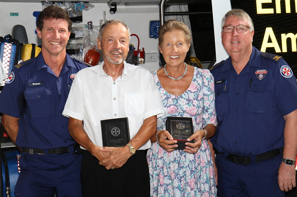 Steve Buster Johnson and his wife Sheila with officers Ronan and Peter of NSW Ambulance at an award ceremony following Sheila's successful recovery from a sudden cardiac arrest