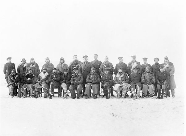 This photograph is of the 6 Squadron pilots and a matchig numbe of Army staf offcers who attended a course in early 1918. Major James seatd with cane.