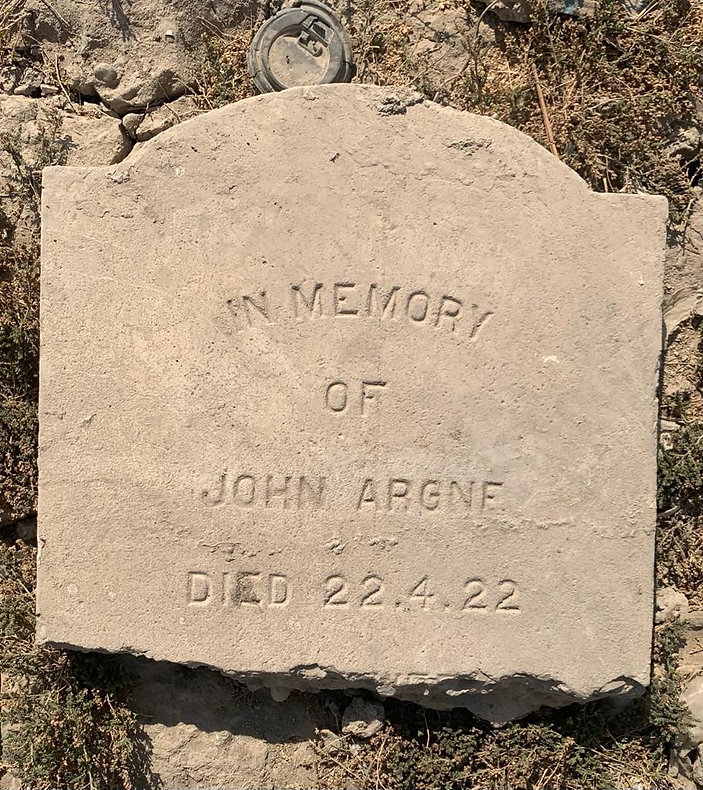 This is a photo of the grave headstone at Hinaidi RAF Cemetery (Ma'asker al Raschid RAF Cemetery) for civilian contractor John Argne