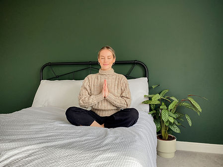 Yoga instructor, Emma Berry, meditating on bed during her virtual brand photoshoot.