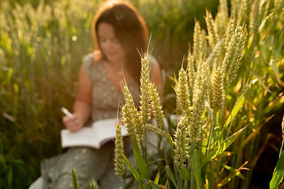 Liverpool nutritionist journaling in the Wirral wheat fields.