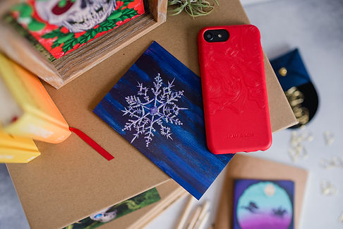 Skull art print and vegan phone case photographed together in group product photography session.