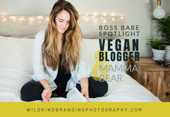 Vegan blogger and influencer sat on her bed in Seattle, going through book during her personal branding photoshoot.