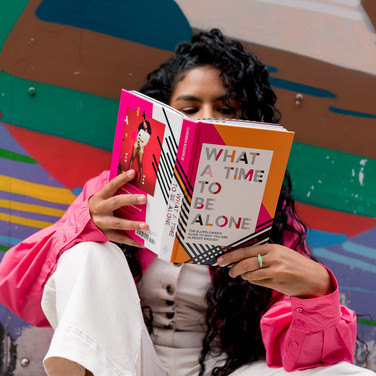 Reading in front of colorful wall during Liverpool Personal Branding Photoshoot