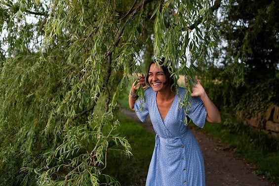 Lancashire yoga instructor & hypnotherapist, Bianca Kumari posing under a tree at the top locks in Burscough.
