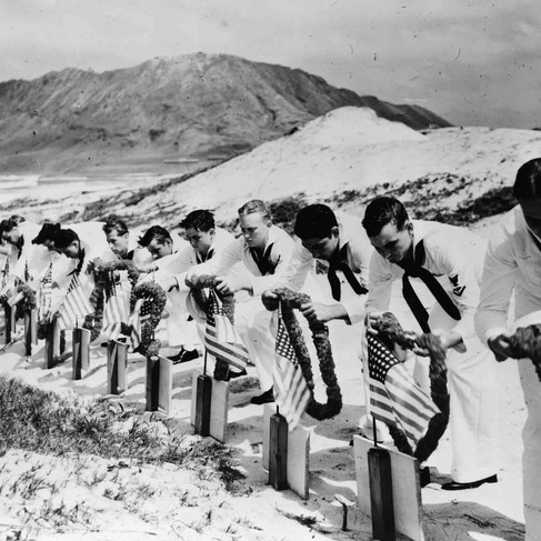 """""""Seamen at Kaneohe Naval Air Station decorate the graves of their fellow sailors killed at Pearl Harbor, December 7, 1941""""   (Official U.S. Navy photograph)  December (?), 1941 Hawaii, USA Author Unknown or not provided © courtesy U.S. Navy photograph / Office of War Information Collection / Library of Congress"""