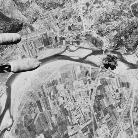 """""""Bombs hurtle toward a Nazi highway bridge. With their rail and shipping facilities almost completely disrupted, the Germans were forced to resort to motor transport. All roads and bridges in central Italy became targets for Allied aerial assaults""""  1944 Central Italy Author unknown or not provided © courtesy Farm Security Administration - Office of War Information photograph collection / Library of Congress"""