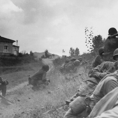"""This Negro combat patrol advanced three miles north of Lucca (furthermost point occupied by American troops) to contact an enemy machine gun nest. Here a bazooka-man cuts loose at the target some 300 yards distant"" With the American soldiers there is also a civilian with a rifle, probably an Italian partisan"