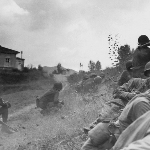"""""""This Negro combat patrol advanced three miles north of Lucca (furthermost point occupied by American troops) to contact an enemy machine gun nest. Here a bazooka-man cuts loose at the target some 300 yards distant"""" With the American soldiers there is also a civilian with a rifle, probably an Italian partisan"""
