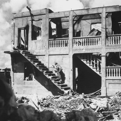 """""""A Marine from the Third Marine Division goes after a sniper in a shelled building.""""  August 1944 Island of Guam (Micronesia), US Territory  Author unknown or not provided © courtesy U.S. National Archives and Records Administration"""