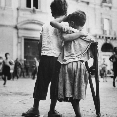 """""""Children in Naples, Italy. Little boy helps one-legged companion across street.""""  August, 1944 Naple, Italy Author unknown or not provided © courtesy U.S. Navy / U.S. National Archives and Records Administration"""