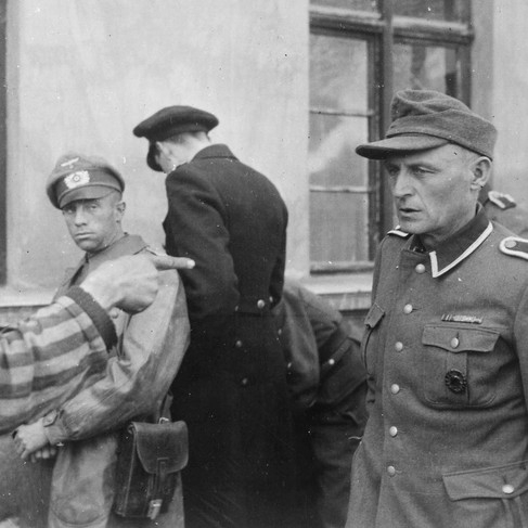 """""""Russian slave laborer among prisoners liberated by 3rd Armored Division points out former Nazi guard who brutally beat prisoners"""""""