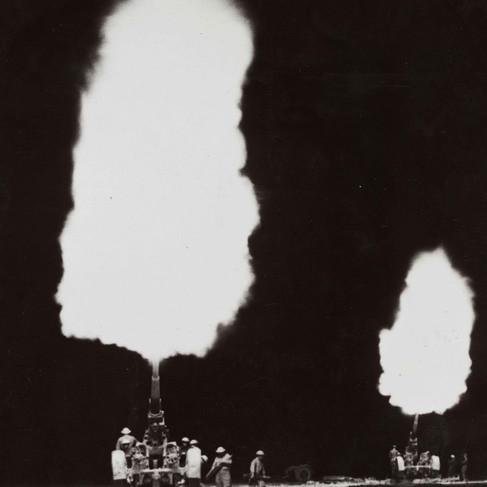 """British anti-aircraft guns illumine the desert near Tobruk during a night raid.""   (British official photograph)  January 23, 1942 Tobruk, Libya Author unknown or not provided © courtesy Library of Congress"