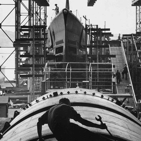 """""""Man working on hull of U.S. submarine at Electric Boat Co., Groton, Conn.""""   August, 1943  Groton, Connecticut, USA Author Charles Fenno Jacobs (1904 – 1974) © courtesy U.S. National Archives and Records Administration"""