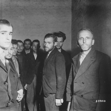 """German Gestapo agents arrested after the fall of Liege, Belgium, are herded together in a cell in the citadel of Liege"""