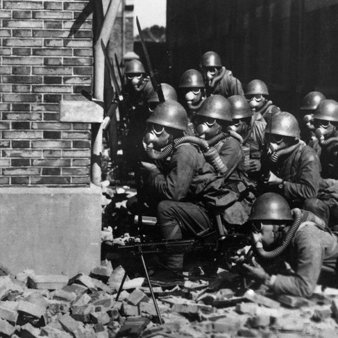 """""""Special Naval Landing Forces troops in gas masks prepare for an advance in the rubble of Shanghai. Chemical weapons were utilized against the Chinese during the battle.""""   August, 1937 Shanghai, China Author unknown Source Imperial Japanese Navy photo from Brent Jones Collection (www.ussastoria.org)"""