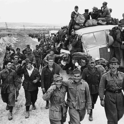 """""""Axis prisoners of war are herded out of the city as Allied armies enter Tunis.""""  May, 1943 Tunis, Tunisia Author unknown or not provided © courtesy Franklin D. Roosevelt Library Public Domain Photographs, 1882 - 1962 Collection / U.S. National Archives and Records Administration"""